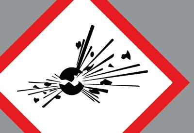Vit illustrerad skylt med röd ram och en svart explosion